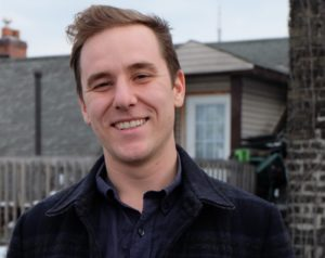 Ryan MacKellar, a Freelance Copywriter and SEO Specialist on the roof of his Toronto home